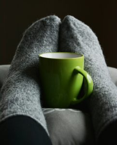 Woollen socks and a hot drink to stay warm