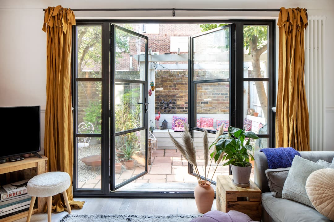french doors opening onto urban courtyard garden