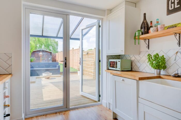 white french door opening out onto a suburban garden
