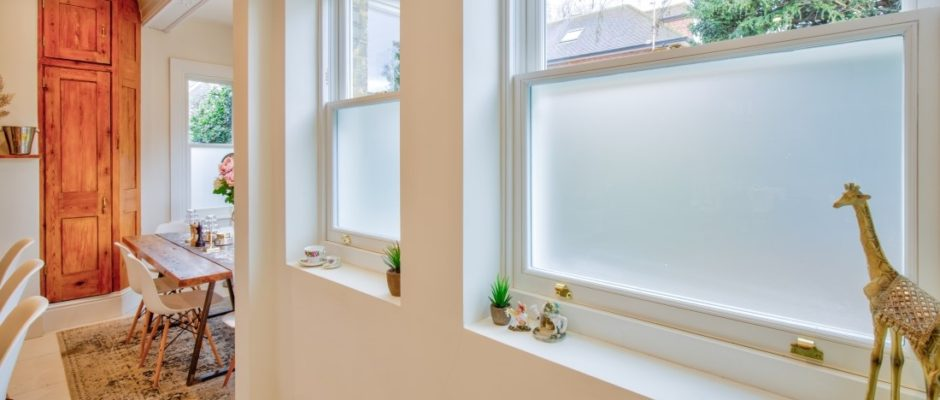 Sash windows with obscured, frosted bottom glass panes