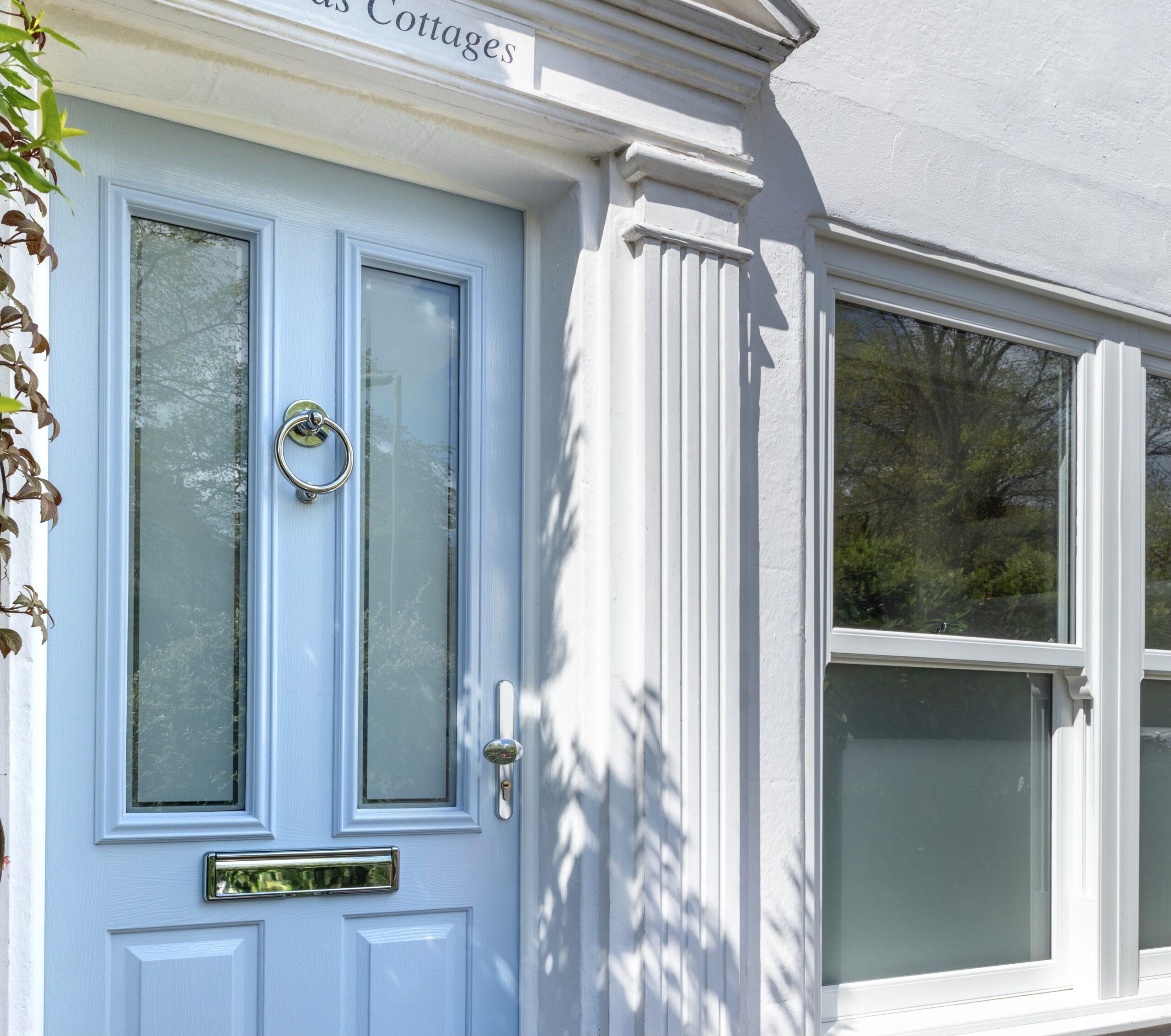 a pale blue composite entrance door