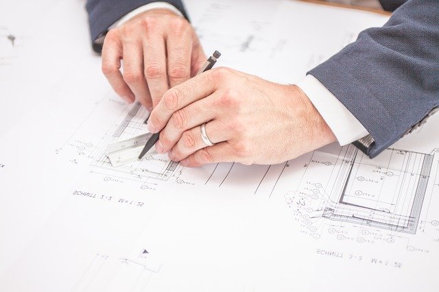 an architect obeying planning rules as he designs a house